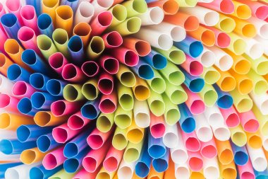 Close up of colorful and bright plastic straws with copy space stock vector