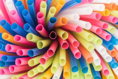 close up of colorful and bright plastic straws with copy space