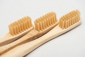 close up view of organic bamboo toothbrushes on grey