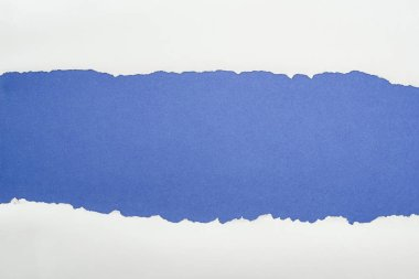 Ragged white textured paper with copy space on deep blue background stock vector