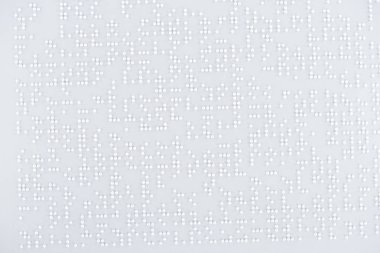 Top view of text in international braille code on white paper stock vector
