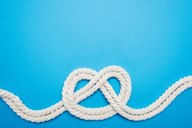 white ropes with sailor knot isolated on blue