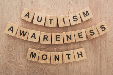 top view of autism awareness month words made of wooden cubes