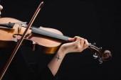 Fotografie Teilansicht der Frau mit Tattoo spielt Cello mit Bogen isoliert auf schwarz