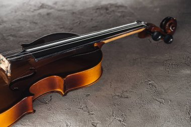 classical violoncello in darkness on textured surface