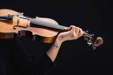 partial view of woman with tattoo playing cello isolated on black