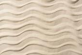 a textúrázott háttér homokkal és sima hullámainak felülnézete