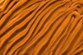 felülnézet textúrázott homok hullámokkal és narancssárga színszűrővel