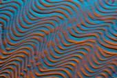 top view of sandy background with color filter and abstract waves