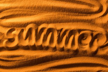 Top view of word summer written in sand with smooth waves and color filter stock vector