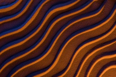 Top view of abstract wavy background with sand and color filter stock vector