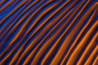 top view of abstract wavy background with sand and color filter