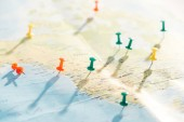 Fotografie selective focus of world map with colorful push pins