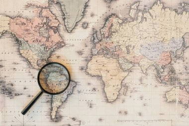 Top view of magnifying glass on world map stock vector