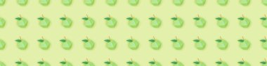 Panoramic shot of pattern with handmade paper apples isolated on green stock vector