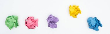 panoramic shot of colorful crumpled paper balls Isolated On White, solution concept