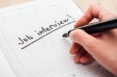 Fényképek levágott kilátás-ból ember írás-ban jegyzetfüzet-val fekete munka interjú betűk