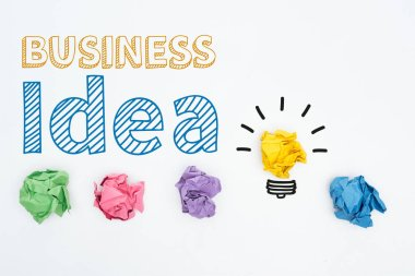 Top view of business idea inscription near colorful crumpled paper balls on white background, business concept stock vector
