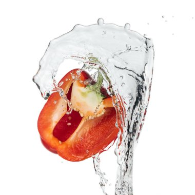 red bell pepper half with clear water isolated on white