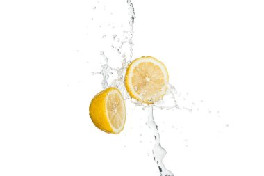 yellow cut fresh lemons with clear water splash and drops isolated on white
