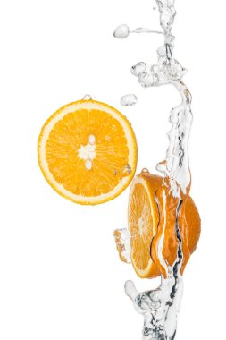 Fresh orange halves with clear water splash and drops isolated on white stock vector
