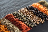 Photo close up view of traditional indian spices in row