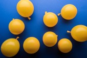 Fotografie  Decorative yellow balloons on blue bright background