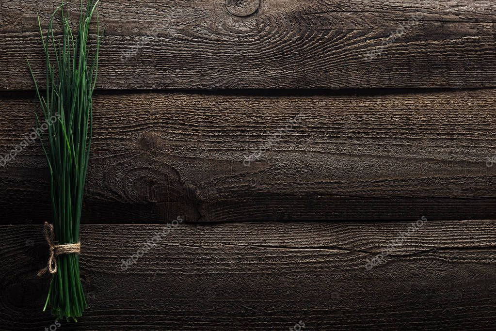 top view of green onion on wooden weathered table with copy space