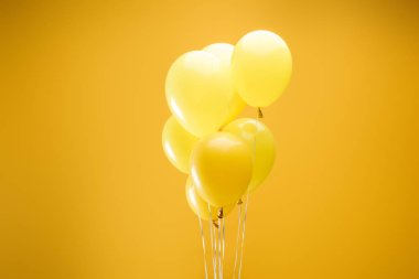 Colorful minimalistic decorative balloons on yellow background stock vector