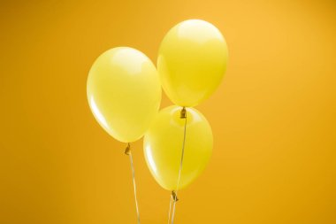 festive colorful minimalistic decorative balloons on yellow background