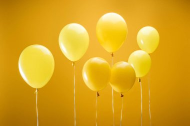 Festive bright minimalistic balloons on yellow background stock vector