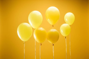 Festive minimalistic decorative balloons on yellow background stock vector