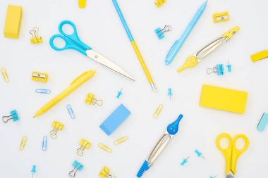 Mix of blue and yellow stationery on white background stock vector