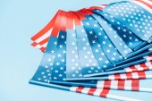 close up view of satin american flags on blue background