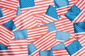 background of shiny national american flags in stack