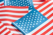 close up view of national american flags in pile