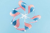 top view of american flags in circle on blue background