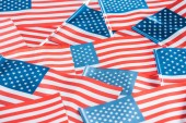 close up view of national usa flags in pile