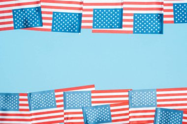 frame of american flags on blue background with copy space