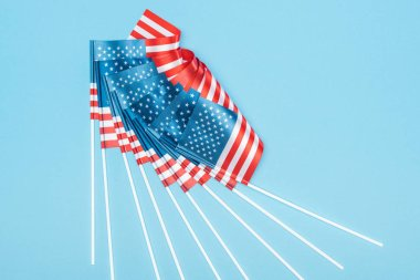 Top view of american flags on sticks on blue background stock vector