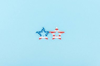 Top view of paper cut decorative glasses made of american flag on blue background stock vector