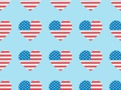 seamless background pattern with paper cut hearts made of usa flags on blue