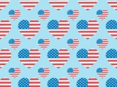 seamless background pattern with paper cut hearts made of american flags on blue