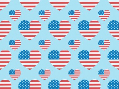 Seamless background pattern with paper cut hearts made of american flags on blue stock vector