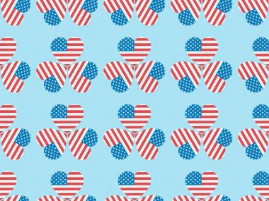 seamless background pattern with hearts made of usa flags on blue