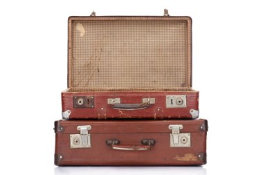 Two vintage brown leather suitcases with one opened isolated on white stock vector