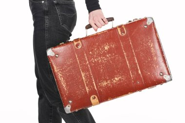 Cropped view of girl in jeans holding vintage weathered suitcase isolated on white stock vector