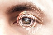 close up view of man brown eye with data illustration, robotic concept