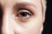 közelről kilátás fiatal nő szürke szeme nézett kamera