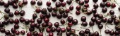 panoramic shot of fresh, sweet, red and ripe cherries with droplets on wooden table